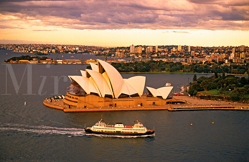 Opera House, Sydney, Australia.  The harbour/harbor and ferry boat.