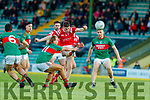 Ronan Buckley, East Kerry in action against Fiachra Clifford and Peter Crowley Mid Kerry during the Kerry County Senior Football Championship Final match between East Kerry and Mid Kerry at Austin Stack Park in Tralee on Saturday night.
