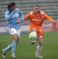 Sky Blue FC midfielder Jen Buczkowski (4) receives the ball while being pressured by Chicago Red Stars forward Cristiane (11).  The Chicago Red Stars tied Sky Blue FC 0-0 at Toyota Park in Bridgeview, IL on April 19, 2009.