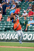 Syracuse Mets first baseman Dilson Herrera (16) catches a popup during an International League game against the Indianapolis Indians on July 17, 2019 at Victory Field in Indianapolis, Indiana.  Syracuse defeated Indianapolis 15-5  (Mike Janes/Four Seam Images)