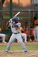 Cristian Gomez #18 of the AZL Dodgers bats against the AZL Athletics at Phoenix Municipal Stadium on July 10, 2013 in Phoenix, Arizona. AZL Athletics defeated the AZL Dodgers, 7-1. (Larry Goren/Four Seam Images)