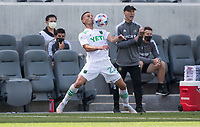 LOS ANGELES, CA - APRIL 17: Ben Sweat #22 of Austin FC traps a ball with LAFC head coach Bob Bradley looking on during a game between Austin FC and Los Angeles FC at Banc of California Stadium on April 17, 2021 in Los Angeles, California.