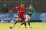 22.11.2020, Dietmar-Scholze-Stadion an der Lohmuehle, Luebeck, GER, 3. Liga, VfB Luebeck vs FC Bayern Muenchen II <br /> <br /> im Bild / picture shows <br /> Leon Dajaku (FC Bayern Muenchen II) im Laufduell mit Florian Riedel (VfB Luebeck) <br /> <br /> DFB REGULATIONS PROHIBIT ANY USE OF PHOTOGRAPHS AS IMAGE SEQUENCES AND/OR QUASI-VIDEO.<br /> <br /> Foto © nordphoto / Tauchnitz