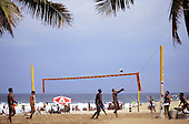 Rio de Janeiro, Brazil. Young men playing volleyball on Copacabana beach.