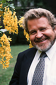 Darrel Posey, smiling, in the garden of the Royal Geographical Society, about 2000.