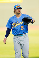 Jake Skole (9) of the Myrtle Beach Pelicans warms up in the outfield prior to the game against the Winston-Salem Dash at BB&T Ballpark on May 15, 2013 in Winston-Salem, North Carolina.  The Pelicans defeated the Dash 9-2.  (Brian Westerholt/Four Seam Images)