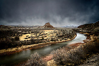 The Chama River meanders into the distance under a leaden sky near the village of Abiquiu in north-central New Mexico.