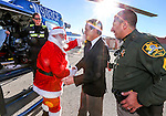 Carson City Mayor Bob Crowell welcomes Santa to the 10th annual Holiday with a Hero event at Walmart in Carson City, Nev., on Wednesday, Dec. 17, 2014. Santa arrives at the event on a Careflight helicopter. <br /> Photo by Cathleen Allison