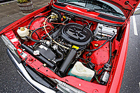 The engine bay of the Mercedes W123 series 230TE estate version, outside the Penderyn Whisky Distillery in south Wales, UK. Tuesday 19 June 2018