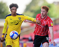 Lincoln City's Callum Morton vies for possession with Oxford United's Sean Clare<br /> <br /> Photographer Chris Vaughan/CameraSport<br /> <br /> The EFL Sky Bet League One - Saturday 12th September 2020 - Lincoln City v Oxford United - LNER Stadium - Lincoln<br /> <br /> World Copyright © 2020 CameraSport. All rights reserved. 43 Linden Ave. Countesthorpe. Leicester. England. LE8 5PG - Tel: +44 (0) 116 277 4147 - admin@camerasport.com - www.camerasport.com - Lincoln City v Oxford United