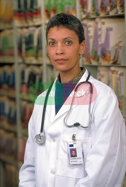 portrait or serious female doctor and medical records