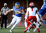 BROOKINGS, SD - MARCH 13: Mark Gronowski #11 of the South Dakota State Jackrabbits looks for running room against the Youngstown State Penguins at Dana J. Dykhouse Stadium on March 13, 2021 in Brookings, South Dakota. (Photo by Dave Eggen/Inertia)