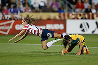 Commerce City, Colorado - Wednesday September 19, 2012; The US WNT defeated the National team of Australia 6-2 during an International friendly game at Dick's Sporting Goods Park.  Alex Morgan (13) of the USWNT is tripped up by Servet Uzunlar (10) of Australia.