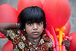 MUMBAI, INDIA - SEPTEMBER 27, 2010: A street urchin selling balloons at the always busy scene of the Gateway to India outside the Taj Mahal Palace and Tower Hotel in Mumbai. The hotel has re-opened after the terror attacks of 2008 destroyed much of the heritage wing. The wing has been renovated and the hotel is once again the shining jewel of Mumbai. pic Graham Crouch