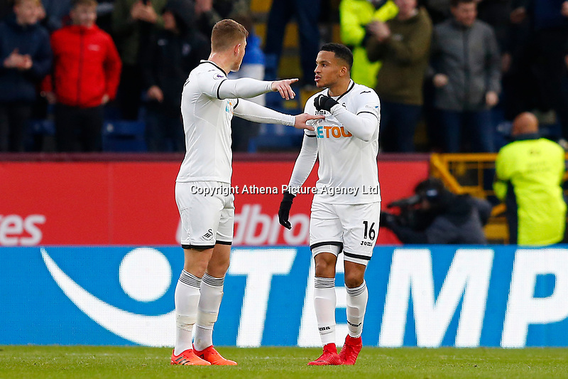 Alfie Mawson and Martin Olsson of Swansea City have a discussion shortly after Burnley score the opening goal during the Premier League match between Burnley and Swansea City at Turf Moor, Burnley, England, UK. Saturday 18 November 2017