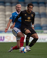 Milton Keynes Cameron Jerome (right) is tackled by Portsmouth's Jack Whatmough (left) <br /> <br /> <br /> Photographer David Horton/CameraSport<br /> <br /> The EFL Sky Bet League One - Portsmouth v Milton Keynes Dons - Saturday 10th October 2020 - Fratton Park - Portsmouth<br /> <br /> World Copyright © 2020 CameraSport. All rights reserved. 43 Linden Ave. Countesthorpe. Leicester. England. LE8 5PG - Tel: +44 (0) 116 277 4147 - admin@camerasport.com - www.camerasport.com