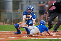 Pitt Panthers catcher Riley Wash (33) attempts to tag Jordan Schaffer (1) sliding home during the teams opening game of the season against the Indiana State Sycamores on February 19, 2021 at North Charlotte Regional Park in Port Charlotte, Florida.  (Mike Janes/Four Seam Images)