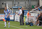 Hartlepool United 0 Middlesbrough 0, 20/07/2013. Victoria Ground, Pre-Season Friendly. Hartlepool United's manager Colin Cooper (white shirt) watching the first-half action at the Victoria Ground, Hartlepool, during a pre-season friendly between the home team and Middlesbrough. Hartlepool were relegated to League Two at the end of the 2012-13 season whilst their Teesside neighbours remained two divisions above them in the Championship. The game ended in a no-score draw watched by a crowd of 2307. Photo by Colin McPherson.