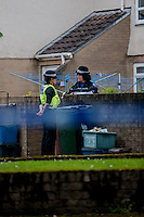 Wednesday 07 May 2014<br /> Pictured: Police Cordon at the end of Salisbury Road, Newport<br /> Re: Gwent police received a call from the ambulance service to a house on Salisbury Close, Newport this morning at about 8am.<br />  <br /> Two children, a 7 year old boy and a 16 month old baby girl, suffered injuries and are currently at the Royal Gwent Hospital receiving treatment.<br />  <br /> A 27 year old woman, from the Newport area, has been arrested on suspicion of attempted murder and has been taken to the Royal Gwent Hospital where she is receiving treatment for injuries.<br />  <br /> A knife has been recovered from the scene.