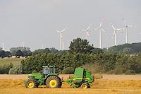 Deutschland Plauerhagen , John Deere Strohballenpresse und ENO Windturbinen im Windpark der MVV Energie Stadtwerke Mannheim / .Germany, John deere tractor with straw press machine and wind turbine of
