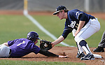 University of Washington's Jayce Ray dives back safely as UC Davis' Spencer Henderson takes the pick-off throw from Spencer Koopmans in a college baseball game in Davis, Ca., on Saturday, Feb. 16, 2013. Davis won the opener 6-5 and dropped the second game 3-2..Photo by Cathleen Allison