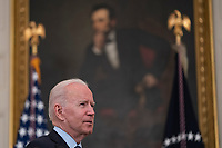 United States President Joe Biden takes questions after delivering remarks on the Covid-19 response and the vaccination program from the State Dining Room of the White House in Washington, DC on Tuesday, May 4, 2021.  The President announced he will allow some governors to turn down doses they don't need or want and reallocate those doses to other states and he also set a goal of getting at least one dose of the Covid-19 vaccine to 70 percent of adults by July 4.<br /> CAP/MPI/RS<br /> ©RS/MPI/Capital Pictures