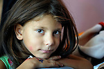 """THIS PHOTO IS AVAILABLE AS A PRINT OR FOR PERSONAL USE. CLICK ON """"ADD TO CART"""" TO SEE PRICING OPTIONS.   A girl in in Suto Orizari, Macedonia. The mostly Roma community, located just outside Skopje, is Europe's largest Roma settlement. ."""