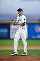 Tri-City Dust Devils starting pitcher Gabriel Morales (13) prepares to deliver a pitch during a Northwest League game against the Vancouver Canadians at Gesa Stadium on August 21, 2019 in Pasco, Washington. Vancouver defeated Tri-City 1-0. (Zachary Lucy/Four Seam Images)