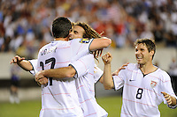 Kenny Cooper (17) of the United States (USA) celebrates scoring the game winning goal with Kyle Beckerman (5) and Logan Pause (8) in overtime. The United States (USA) defeated Panama (PAN) 2-1 during a quarterfinal match of the CONCACAF Gold Cup at Lincoln Financial Field in Philadelphia, PA, on July 18, 2009.