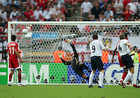England's Wayne Rooney watches teammates Steven Gerrard's long distance shot score for England. England defeated Trinidad & Tobago 2-0 in their FIFA World Cup group B match at Franken-Stadion, Nuremberg, Germany, June 15 2006.