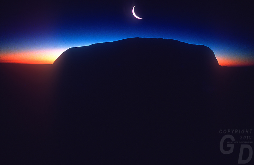 Ayers Rock with Crest moon, Uluru national Park, NT Australia
