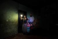 25 noviembre 2014. <br /> María Dolores Caal, de 50 años, y su marido Ramiro Sierra, de 50, viven en Chacalté (Cobán, Guatemala), una pequeña aldea que está muy cerca de la hidroeléctrica Renace pero no tiene luz ni en calles ni en casas. Esta matrimonio tiene que utilizar bombillas solares. Tienen dos hijos: Flor de María, de 5 años, y Essau, de dos. En Cobán (Guatemala) la hidroeléctrica española Renace se ha instalado con amenazas a la población y falsas promesas de desarrollo para la zona. La compañía también ha prohibido el acceso al río Cahabón para miles de personas y no ha respetado la estrecha relación de los indios mayas con el medio ambiente. Renace es una empresa guatemalteca, pero ha dado el contrato de la construcción de la hidroeléctrica a la empresa española Cobra (FCC). El proyecto ha dividido a la población entre partidarios y detractores. ©Calamar2/ Pedro ARMESTRE<br /> <br /> <br /> Maria Dolores Caal, 50 years old and her husband Ramiro Sierra, 52 years old, live in Chacalté (Cobán, Guatemala), a small village that it is very close to the hydroelectric Renace but it has no electricity. They have to use solar bulbs. They have two children: Flor de María, 5 years old, and Esau, two years old, on november 26, 2014. The arrival of foreign companies to Latin America has provoked abuses of the rights of indigenous people and repression of their defense of the environment. In Santa Cruz de Barillas, Guatemala, the project of the Spanish hydroelectric Ecoener has caused murders, violent riots, the declaration of a state of siege by the army and the imprisonment of a dozen activists opposed to the project. They defend their territory and their river, called Cambalam. The river has for the Mayan people a special meaning and it is linked with their ancestors. A group of Mayan Indians, mostly women, has cut a path and has installed a resistance camp to prevent the enter of the company's machines. The prosecution has also provoked that some ecologists,