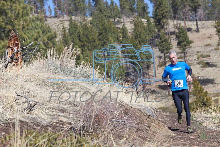 Competitors run the Carson Canyons Half Marathon on the trails above Carson City, Nev., on Saturday, March 7, 2015.<br /> Photo by Rick Gunn