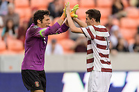 Houston, TX - Friday December 11, 2016: Adam Mosharrafa (16) of the Stanford Cardinal high-fives goalkeeper, Andrew Epstein after making his kick in the overtime shootout against the Wake Forest Demon Deacons at the NCAA Men's Soccer Finals at BBVA Compass Stadium in Houston Texas.
