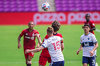 ORLANDO, FL - APRIL 24: Andy Rose #15 of Vancouver Whitecaps battles for the ball during a game between Vancouver Whitecaps and Toronto FC at Exploria Stadium on April 24, 2021 in Orlando, Florida.