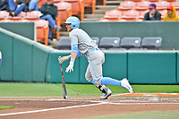 North Carolina Tar Heels first baseman Michael Busch (15) swings at a pitch during a game against the Clemson Tigers at Doug Kingsmore Stadium on March 9, 2019 in Clemson, South Carolina. The Tigers defeated the Tar Heels 3-2 in game one of a double header. (Tony Farlow/Four Seam Images)