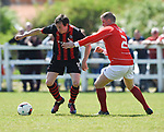 Derek Fahy of Bridge United A in action against Colin Ryan of Newmarket Celtic A during their Clare Cup Final at Frank Healy Park. Photograph by John Kelly.