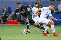 CARSON, CA - MAY 8: Mark-Anthony Kaye #14 of LAFC moves around Javier Hernandez #14 of the Los Angeles Galaxy during a game between Los Angeles FC and Los Angeles Galaxy at Dignity Health Sports Park on May 8, 2021 in Carson, California.