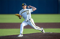 Michigan Wolverines pitcher Jack White (30) delivers a pitch to the plate against the Ohio State Buckeyes on April 9, 2021 in NCAA baseball action at Ray Fisher Stadium in Ann Arbor, Michigan. Ohio State beat the Wolverines 7-4. (Andrew Woolley/Four Seam Images)