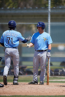 Tampa Bay Rays Chris Betts (26) congratulates Jesus Sanchez (71) after a home run during a minor league Spring Training game against the Baltimore Orioles on March 29, 2017 at the Buck O'Neil Baseball Complex in Sarasota, Florida.  (Mike Janes/Four Seam Images)