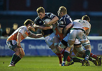 Freddie Clarke of London Scottish Football Club  breaks the tackle during the Greene King IPA Championship match between London Scottish Football Club and Ealing Trailfinders at Richmond Athletic Ground, Richmond, United Kingdom on 26 December 2015. Photo by Alan  Stanford / PRiME Media Images