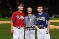 Scottsdale Scorpions Mitch Walding (31), of the Philadelphia Phillies organization, and Peoria Javelinas Michael Gettys (13), of the San Diego Padres organization, are presented with the National League second place trophy bat from Zinger by Josh Michalsen during the Bowman Hitting Challenge on October 8, 2016 at the Salt River Fields at Talking Stick in Scottsdale, Arizona.  (Mike Janes/Four Seam Images)