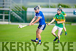 St Brendans Donal O'Sullivan about to hooked by Lixnaw's  Kieran Walsh in the County Minor Hurling championship quarter final on Friday.