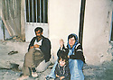 Iran 1991 .In Kani Dinar,  Saadia, wife of Mahmoud Sangawy, with her daughter and  her brother-in-law .Iran 1991 .A Kani Dinar, Saadia, femme de Mahmoud Sangawy avec sa fille et son beau-frere devant sa maison