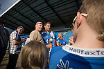 FC Halifax Town 1 Mickleover Sports 1, 23/04/2011. The Shay, Northern Premier League. Home supporters and players mingling on the pitch and having photographs taken at the end of the match at The Shay, home of FC Halifax Town (in blue), on the day that they were presented with the Northern Premier League Premier Division championship trophy following their match with Mickleover Sports, which ended in a 1-1 draw in front of a crowd of 2,404. The club replaced Halifax Town A.F.C. who went into administration during the 2007–08 season, having previously been members of the Football League for 80 years. Their promotion meant they would play in Conference North in the 2011-12 season. Photo by Colin McPherson.