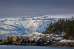 Fresh snow frosts the cliffs of Champlain Mountain, Acadia National Park, ME, USA