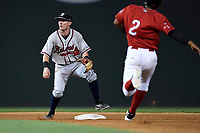 Shortstop Marcus Mooney (2) of the Rome Braves awaits a late throw as Santiago Espinal (2) of the Greenville Drive steals second in a game on Saturday, August 12, 2017, at Fluor Field at the West End in Greenville, South Carolina. Rome won, 4-0. (Tom Priddy/Four Seam Images)
