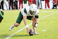 ATHENS, GA - SEPTEMBER 11: Dylan Hopkins #9 of the UAB Blazers attempts to pick up his fumbled snap during a game between University of Alabama Birmingham Blazers and University of Georgia Bulldogs at Sanford Stadium on September 11, 2021 in Athens, Georgia.
