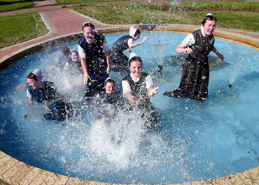 Hutterite women cool off in the Crescent Park fountain on a hot summer day. MARK TAYLOR GALLERY