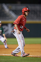 Garrett Suggs (10) of the North Carolina State Wolfpack takes his lead off of third base against the Charlotte 49ers at BB&T Ballpark on March 29, 2016 in Charlotte, North Carolina. The Wolfpack defeated the 49ers 7-1.  (Brian Westerholt/Four Seam Images)